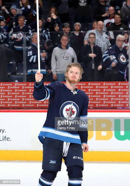 Kyle Connor of the Winnipeg Jets salutes the fans after receiving first star honours following a 21 overtime victory over the Los Angeles Kings at...