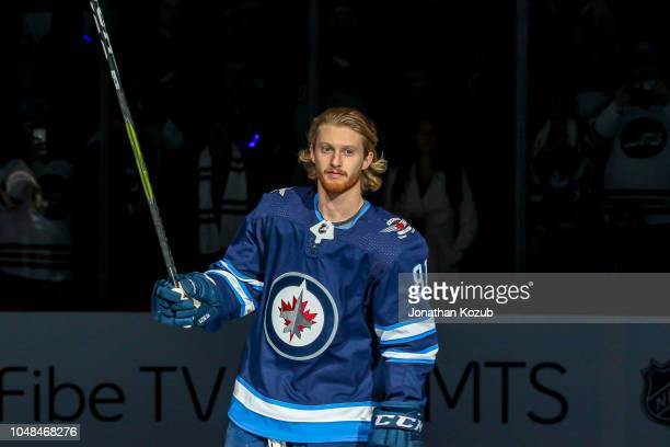 Kyle Connor of the Winnipeg Jets salutes the fans during the player introductions prior to the home opener against the Los Angeles Kings at the Bell...