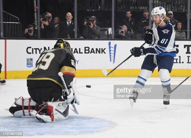 Kyle Connor of the Winnipeg Jets scores a firstperiod goal against MarcAndre Fleury of the Vegas Golden Knights during their game at TMobile Arena on...
