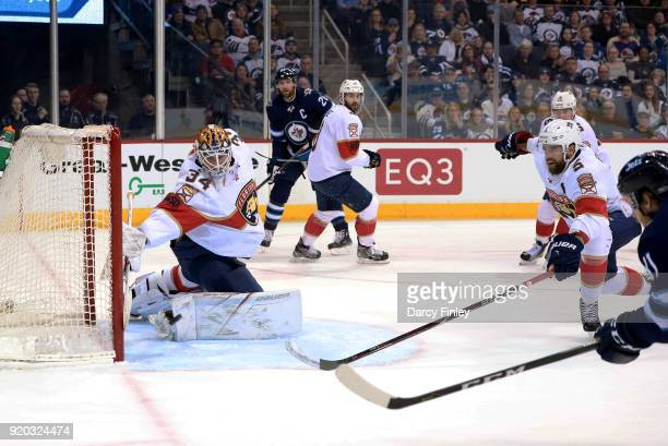 Kyle Connor of the Winnipeg Jets shoots the puck into the net past a diving James Reimer of the Florida Panthers for a first period goal at the Bell...