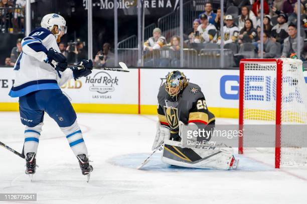 Kyle Connor of the Winnipeg Jets shoots the puck past goaltender MarcAndre Fleury of the Vegas Golden Knights for a first period goal at TMobile...