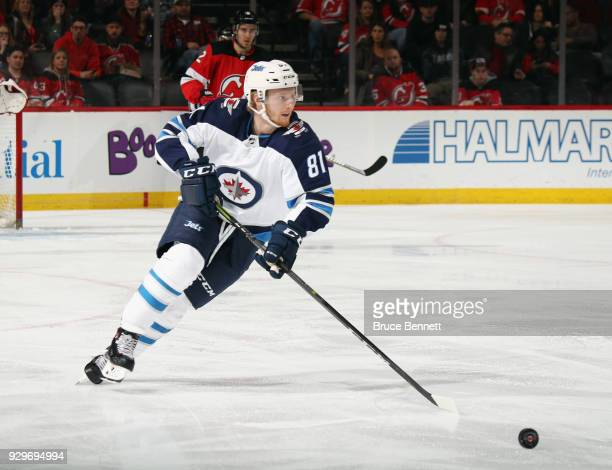 Kyle Connor of the Winnipeg Jets skates against the New Jersey Devils at the Prudential Center on March 8 2018 in Newark New Jersey
