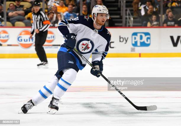 Kyle Connor of the Winnipeg Jets skates against the Pittsburgh Penguins at PPG Paints Arena on October 26 2017 in Pittsburgh Pennsylvania