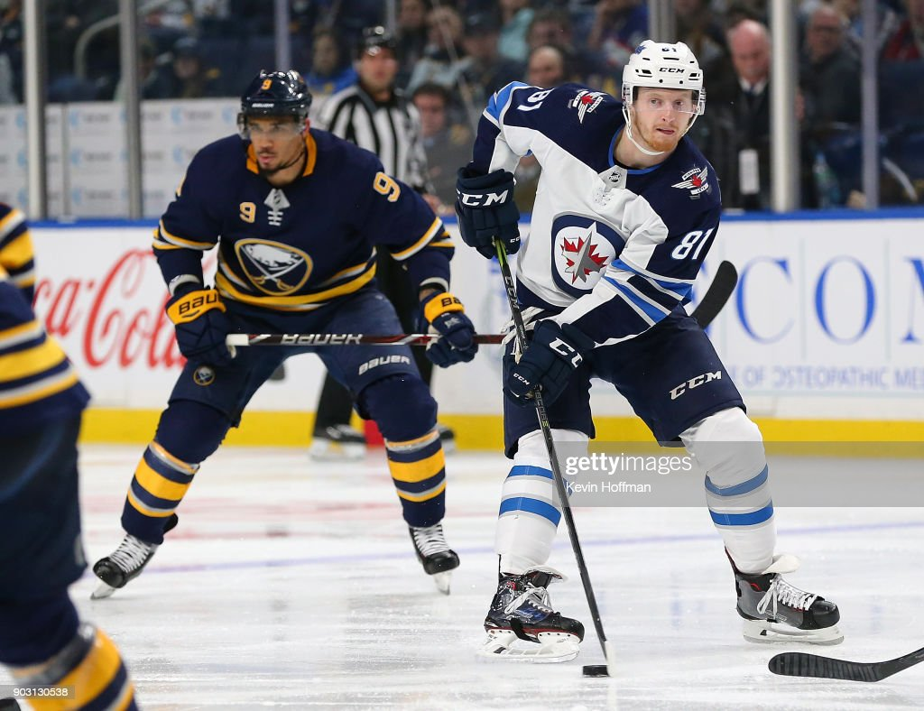 Kyle Connor #81 of the Winnipeg Jets skates up ice with the puck in the third period as Evander Kane #9 of the Buffalo Sabres pursues. Kyle Connor #81 had two goals in the game at the KeyBank Center on January 9, 2018 in Buffalo, New York. The Jets beat the Sabres 7-4.