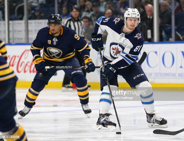 Kyle Connor of the Winnipeg Jets skates up ice with the puck in the third period as Evander Kane of the Buffalo Sabres pursues Kyle Connor had two...