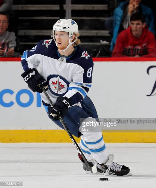 Kyle Connor of the Winnipeg Jets takes the puck in the third period against the New Jersey Devils at Prudential Center on December 01 2018 in Newark...
