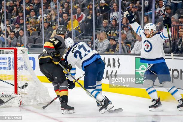 Kyle Connor of the Winnipeg Jets throws up his arms in celebration of a first period goal by teammate Nikolaj Ehlers against the Vegas Golden Knights...
