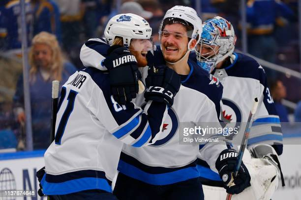 Kyle Connor the Winnipeg Jets is congratulated by Jack Roslovic of the Winnipeg Jets after scoring the game-winning goal in overtime against the St....