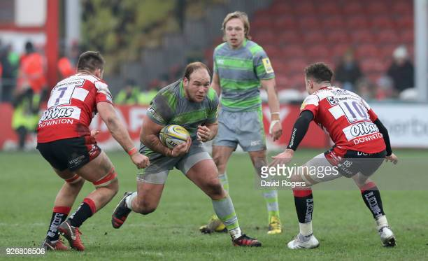 Kyle Cooper of Newcastle takes on Jake Polledri and Billy Burns during the Aviva Premiership match between Gloucester Rugby and Newcastle Falcons at...