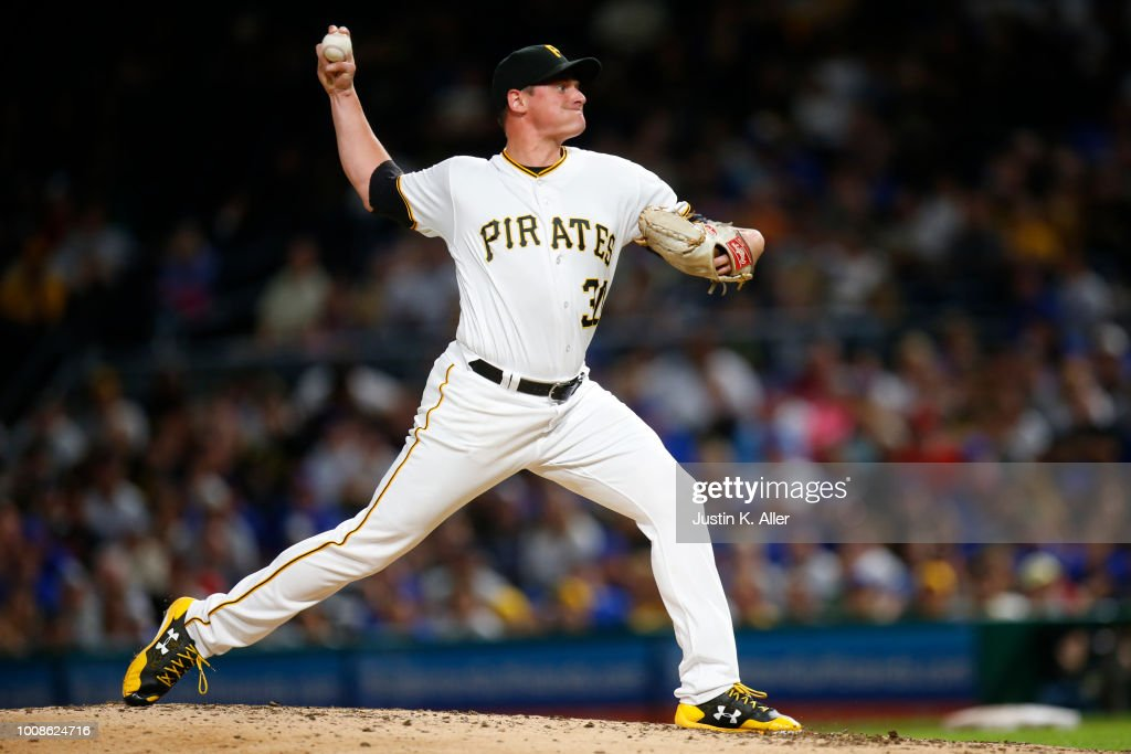 Kyle Crick #30 of the Pittsburgh Pirates pitches in the eighth inning against the Chicago Cubs at PNC Park on July 31, 2018 in Pittsburgh, Pennsylvania.