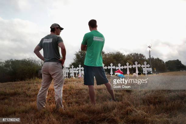 Kyle Dahlderg and Kevin Blomstrum view a memorial where 26 crosses stand in a field on the edge of town to honor the 26 victims killed at the First...