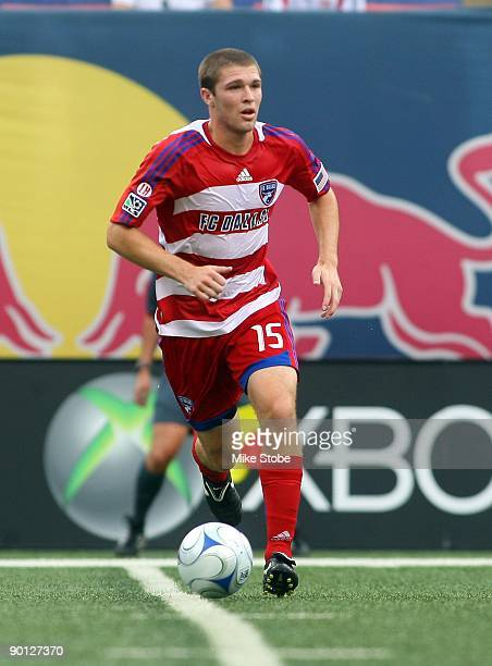 Kyle Davies of the FC Dallas plays the ball against the New York Red Bulls at Giants Stadium in the Meadowlands on August 23 2009 in East Rutherford...