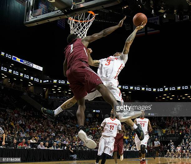 Kyle Davis of the Dayton Flyers attempts a shot against Shavar Newkirk of the Saint Joseph's Hawks in the semifinals round of the men's Atlantic 10...