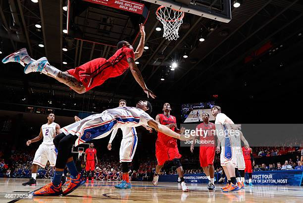 Kyle Davis of the Dayton Flyers goes to the basket against Chandler Hutchison of the Boise State Broncos during the first round of the 2015 NCAA...