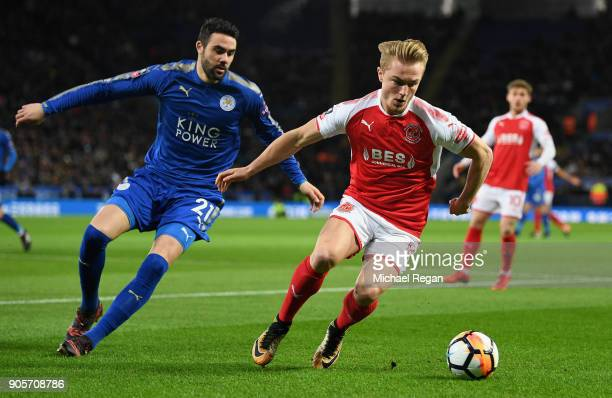 Kyle Dempsey of Fleetwood Town evades Vicente Iborra of Leicester City during The Emirates FA Cup Third Round Replay match between Leicester City and...