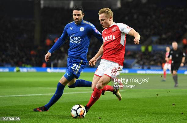 Kyle Dempsey of Fleetwood Town is marshalled by Vicente Iborra of Leicester City during The Emirates FA Cup Third Round Replay match between...