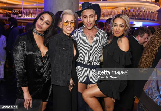 Kyle De'Volle poses with Alexandra Buggs Courtney Rumbold and Karis Anderson of Stooshe at the launch of the JF London x Kyle De'Volle fall/winter...