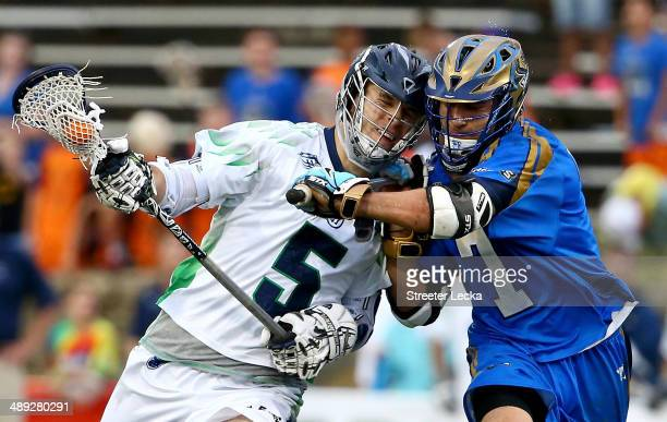 Kyle Dixon of the Chesapeake Bayhawks runs into Jake Tripuka of the Charlotte Hounds during their game at American Legion Memorial Stadium on May 10...