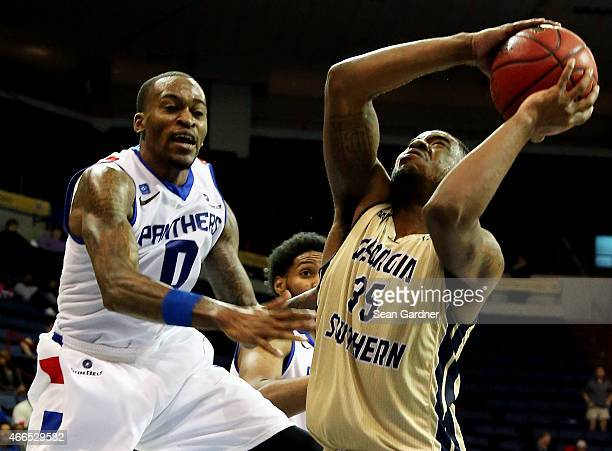 Kyle Doyle of the Georgia Southern Eagles pulls dow a rebound over Kevin Ware of the Georgia State Panthers during the Sun Belt Conference Men's...