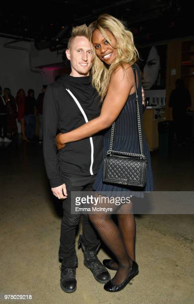Kyle Draper and Laverne Cox attend MAC Cosmetics Aaliyah Launch Party on June 14 2018 in Hollywood California