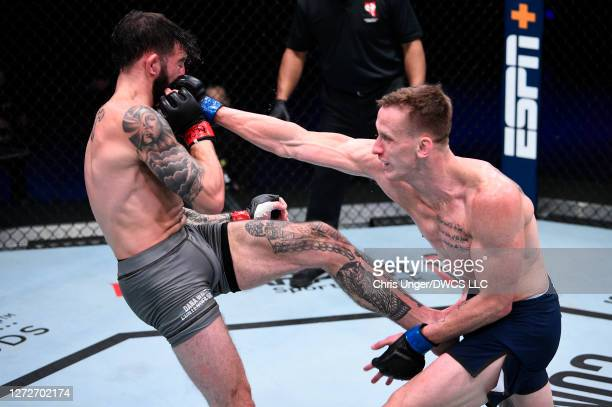 Kyle Driscoll punches Dinis Paiva in their featherweight bout during week seven of Dana White's Contender Series season four at UFC APEX on September...