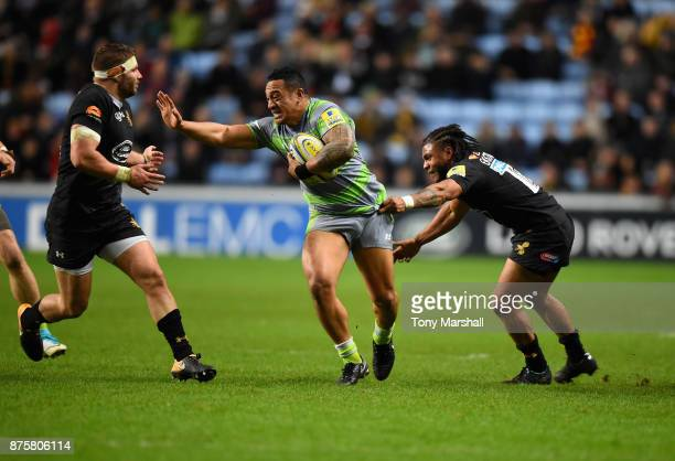 Kyle Eastmond and Thomas Young of Wasps tackle Sinoti Sinoti of Newcastle Falcons during the Aviva Premiership match between Wasps and Newcastle...