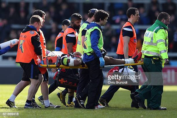 Kyle Eastmond of Bath Rugby is stretched off during the Aviva Premiership match between Sale Sharks and Bath Rugby at the AJ Bell Stadium on April 17...
