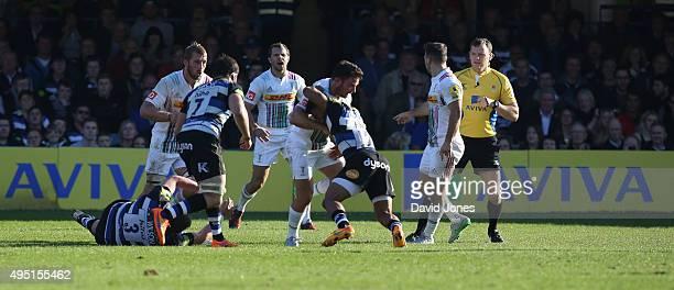 Kyle Eastmond of Bath Rugby tackles George Lowe of Harlequins during the Aviva Premiership match between Bath Rugby and Harlequins at the Recreation...