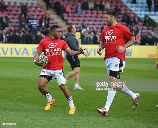 Kyle Eastmond of Bath runs with the ball wearing the Restart Rugby T shirt in the warm up during the Aviva Premiership match between Harlequins and...