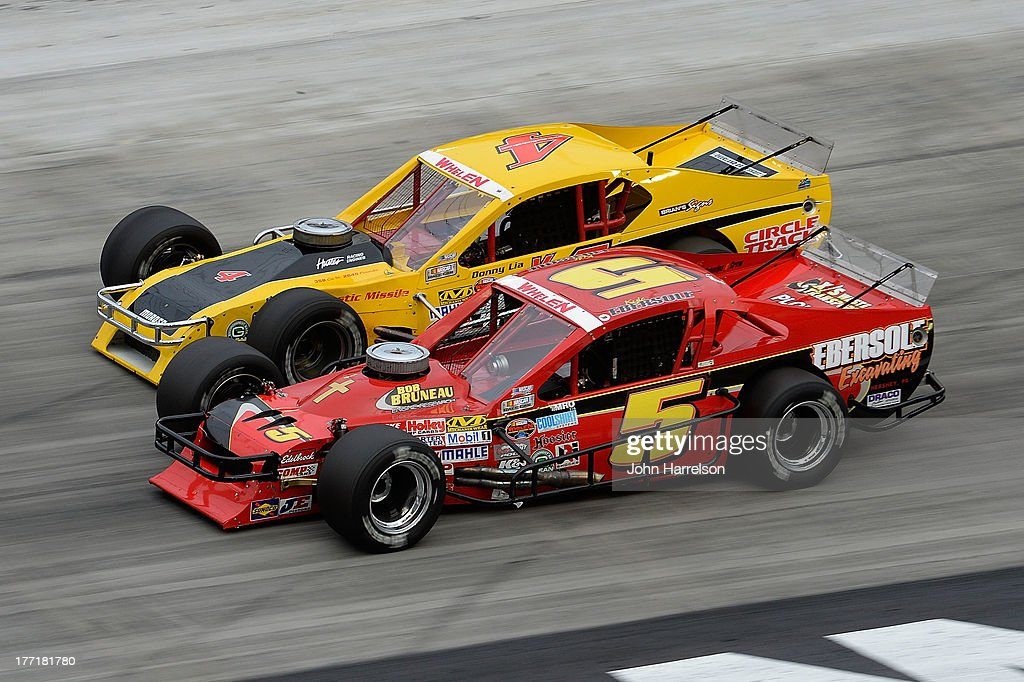 Kyle Ebersole, driver of the #5 Ebersole Excavating Ford, races with Donny Lia, driver of the #4 Circle Track Magazine Dodge during the TitanRoof 150 at Bristol Motor Speedway on August 21, 2013 in Bristol, Tennessee.