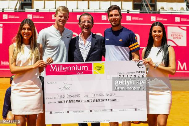 Kyle Edmund Engineer Rui Teixeira administrator of MillenniumBCP and Cameron Norrie receiving the prize money of the pairs competition after the...