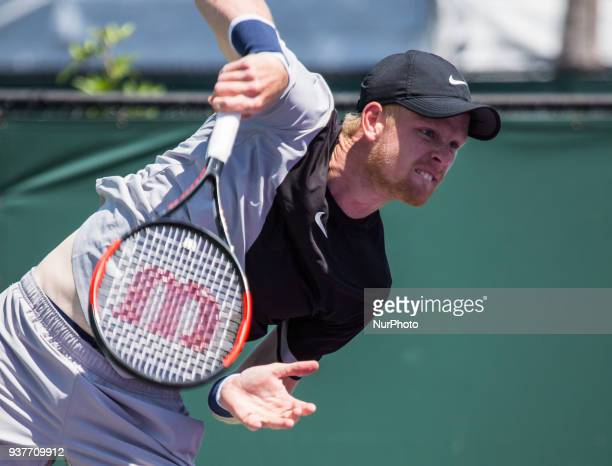 Kyle Edmund from Great Britain in action against Frances Tiafoe from the USA playing for the second round match at the Miami Open on March 24 2018 in...