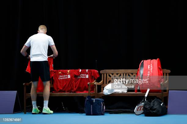 Kyle Edmund lays out his Liverpool FC shirts ahead of his singles match against Liam Broady on day 4 of Schroders Battle of the Brits at the National...