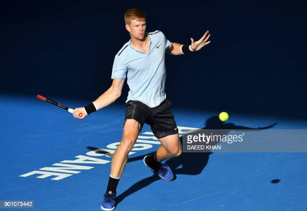 Kyle Edmund of Britain hits a return against South Korea's Chung Hyeon during their men's singles second round match at the Brisbane International...