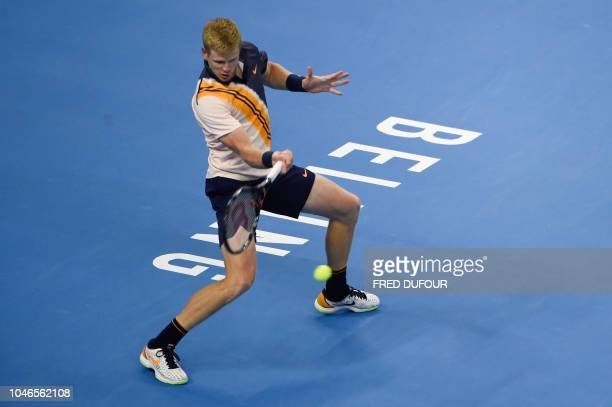 Kyle Edmund of Britain returns a hit during his men's singles semifinal match against Nikoloz Basilashvili of Georgia at the China Open tennis...