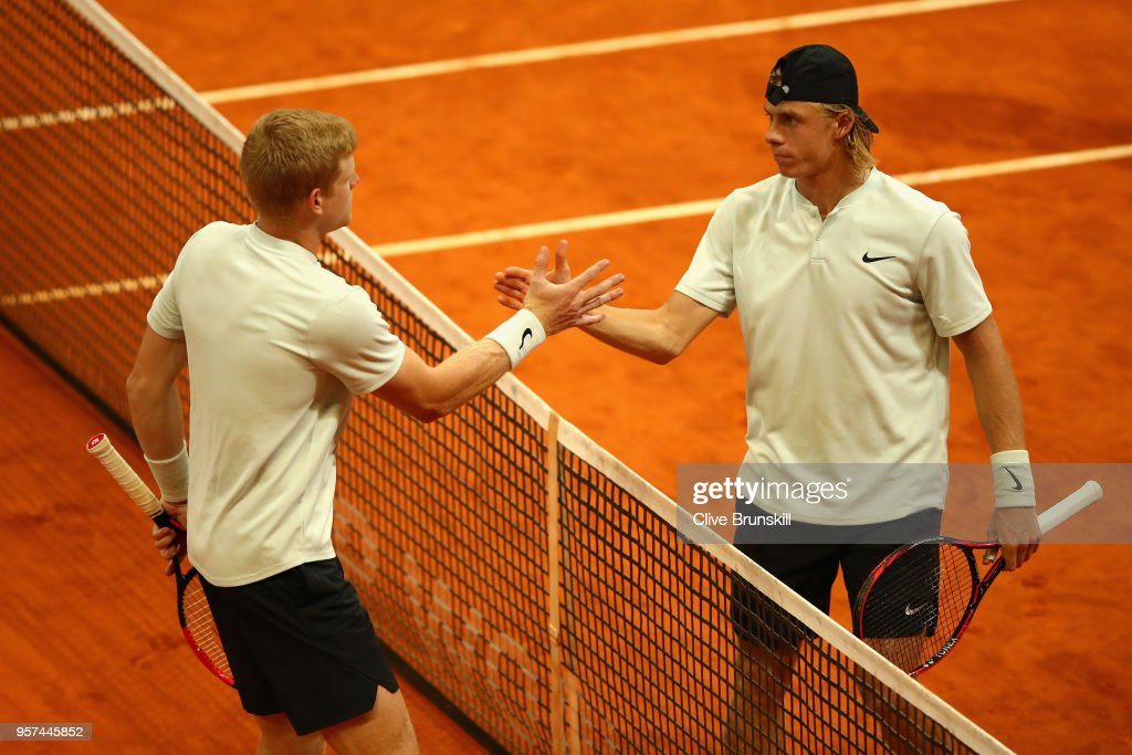 Kyle Edmund of Great Britain (L) and Denis Shapvalov of Canada (R) shake hands after their singles match during day seven of Mutua Madrid Open at La Caja Magica on May 11, 2018 in Madrid, Spain.