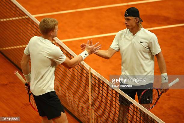 Kyle Edmund of Great Britain and Denis Shapvalov of Canada shake hands after their singles match during day seven of Mutua Madrid Open at La Caja...