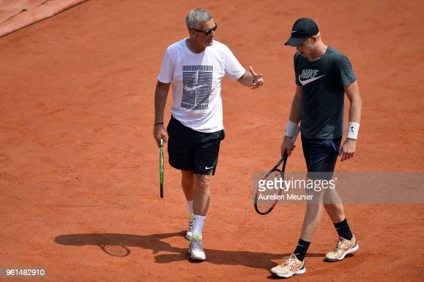 Kyle Edmund of Great Britain and his coach Fredrik Rosengren speak during a practice session ahead of the French Open at Roland Garros on May 22 2018...