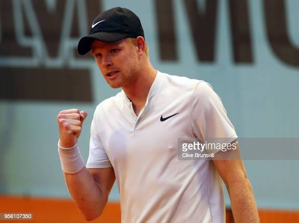 Kyle Edmund of Great Britain celebrates at match point as he defeats Daniil Medvedev of Russia during day four of the Mutua Madrid Open tennis...
