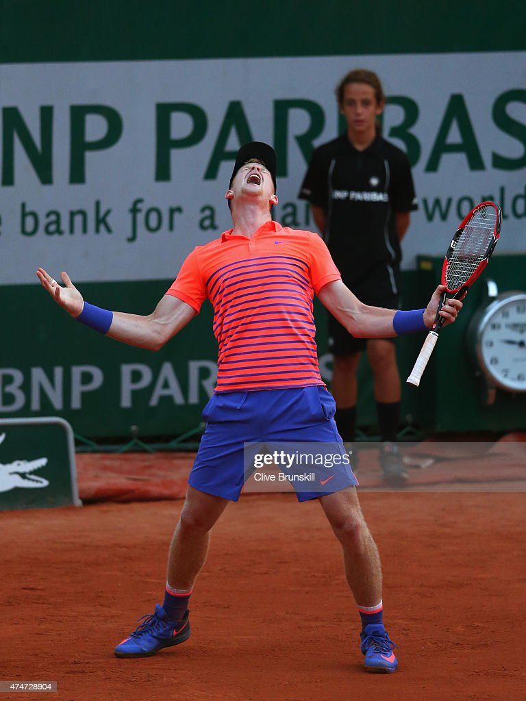 Kyle Edmund of Great Britain celebrates match point during his men's singles match against Stephane Robert of France on day two of the 2015 French Open at Roland Garros on May 25, 2015 in Paris, France.