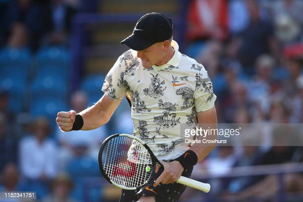 Kyle Edmund of Great Britain celebrates winning his men's singles quarterfinal match against Daniel Evans of Great Britain during day four of the...