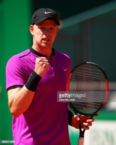 Kyle Edmund of Great Britain celebrates winning the first set against Dan Evans of Great Britain in their first round match on day two of the Monte...