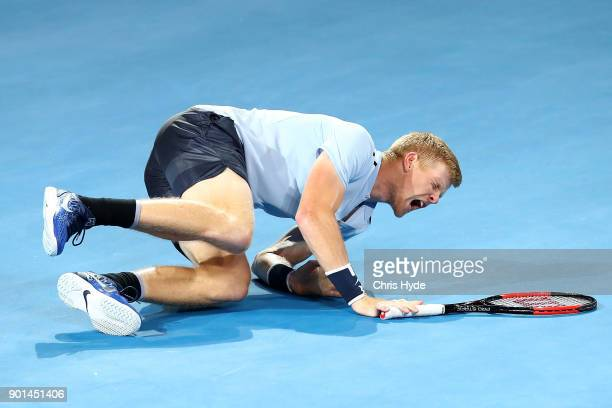 Kyle Edmund of Great Britain falls in his match against Grigor Dimitrovof of Bulgaria during day six of the 2018 Brisbane International at Pat Rafter...