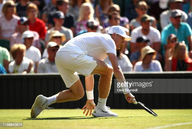 Kyle Edmund of Great Britain falls in his Men's Singles second round match against Fernando Verdasco of Spain during Day three of The Championships -...