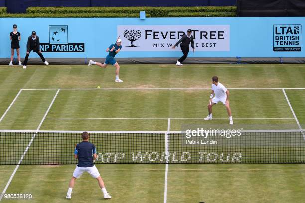 Kyle Edmund of Great Britain hits a backhand during the doubles match against Nick Kyrgios of Australia and Lleyton Hewitt of Australia while playing...
