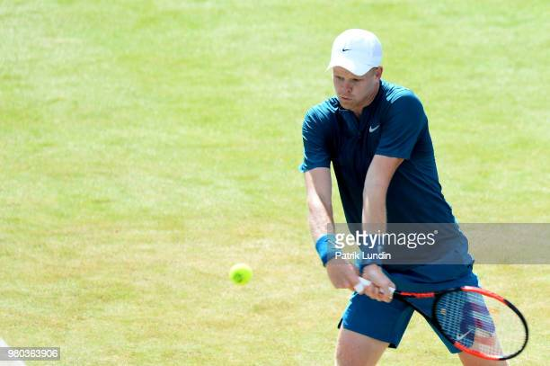 Kyle Edmund of Great Britain hits a backhand during the match against Nick Kyrgios of Australia during Day four of the FeverTree Championships at...
