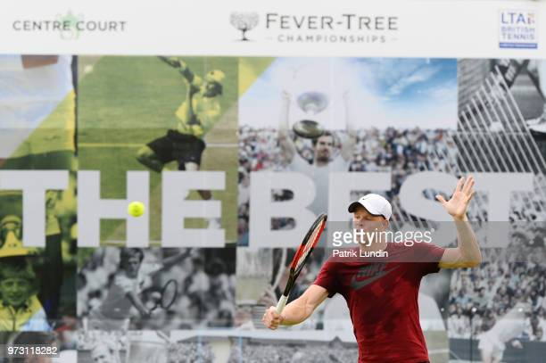 Kyle Edmund of Great Britain hits a backhand in practice with Grigor Dimitrov of Bulgaria during preevent Day 1 of the FeverTree Championships at...