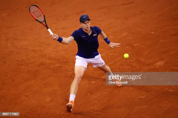 Kyle Edmund of Great Britain hits a forehand during the singles match against Lucas Pouille of France on day one of the Davis Cup World Group...