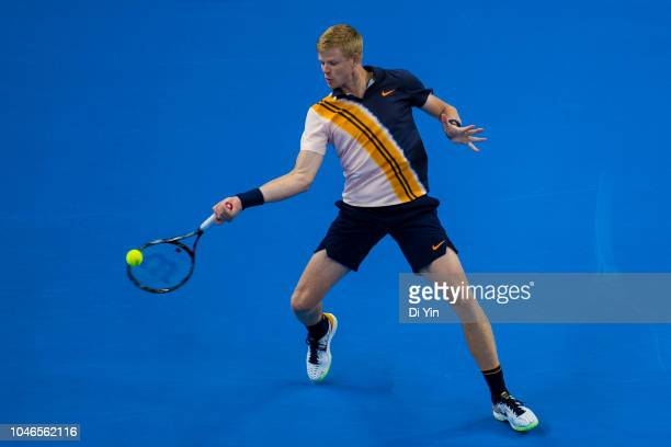 Kyle Edmund of Great Britain hits a return against Nikoloz Basilashvili of Georgia during his Men's Singles Semifinals match in the 2018 China Open...