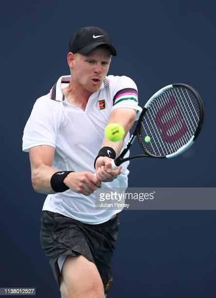 Kyle Edmund of Great Britain in action against Milos Raonic of Canada during day seven at the Miami Open Tennis on March 24, 2019 in Miami Gardens,...